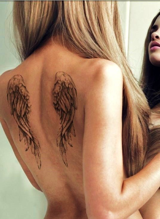 beautiful angel wings tattoo: