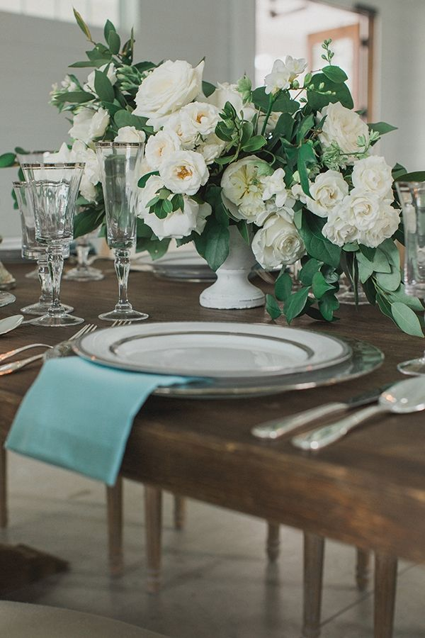 Elegant white centerpiece on a farmhouse table | Photo by Elle Boone