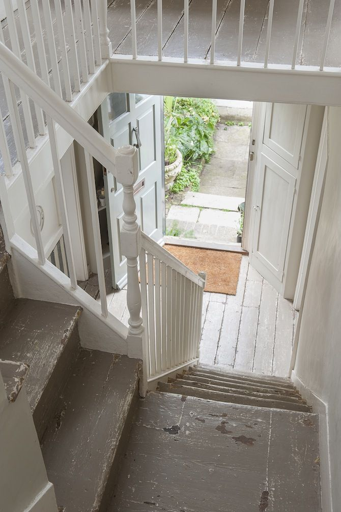 The hallway is made light and airy with cream coloured walls and grey distressed stairs...  #wealdentimesinteriors