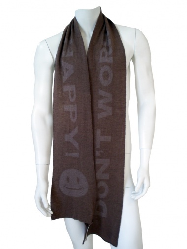 """Designer: Jan & Carlos    Item: Scarf with text    Composition: 100% Merinos Wool    Made in Italy    Description:    Scarf in merinos Extrafine with picture """"Smiling Sun"""" in matching bicolours.      > Need Help?    Price $ 122.00 $61.00    Discount: -50%"""