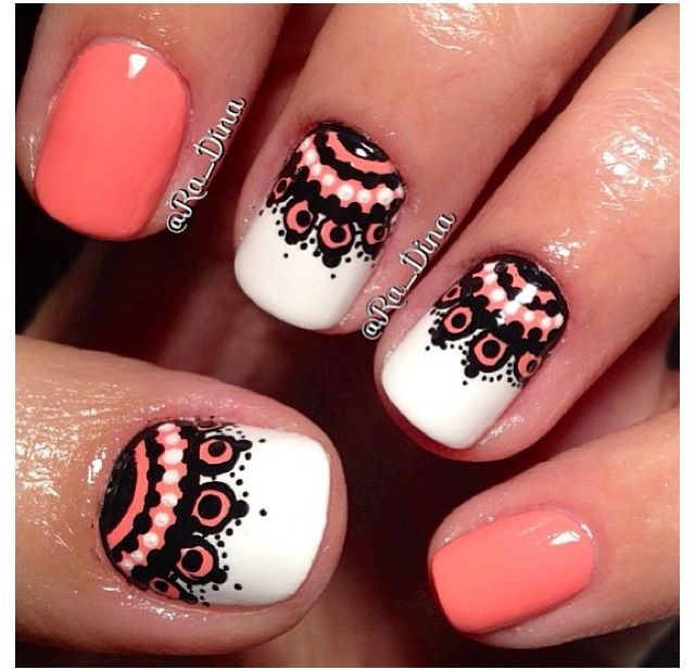 Orange, black, and white nails