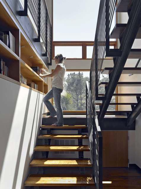 open riser staircase + bookshelf