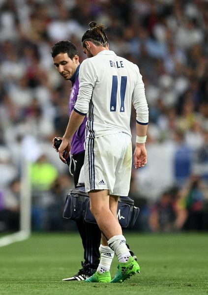 An injured Gareth Bale of Real Madrid leaves the pitch during the La Liga match between Real Madrid CF and FC Barcelona at Estadio Bernabeu on April 23, 2017 in Madrid, Spain.