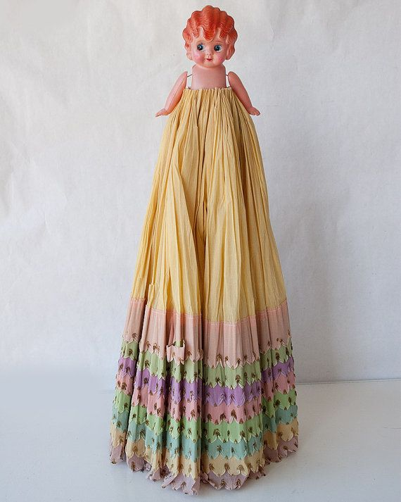 Vintage celluloid flapper style doll with crepe paper dress--Japan. Colorful dress with scalloped edges and dark golden details. Very sweet face with molded hair and dangly arms. What a charmer--she would make a lovely wall hanging with her fully open skirt!  Condition: arms are a bit wiggly(small string holding them together), few scratches to hair, as can be expected from her age--there is wrinkling and several tears to her paper skirt  Size approx: 24 in tall--doll and skirt 42 in…