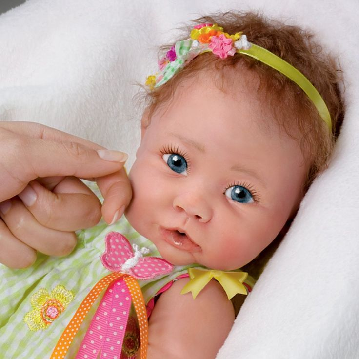 Amazon Com Touch Activated Lifelike Baby Doll Butterfly