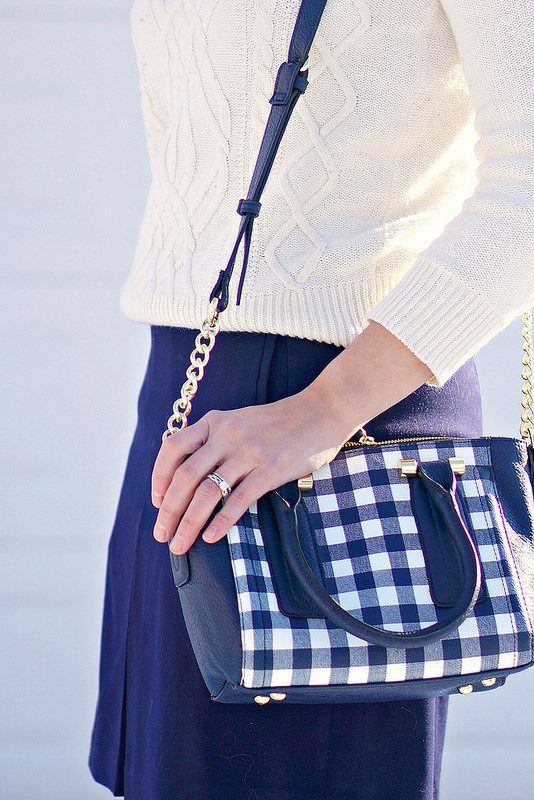 navy gingham print purse, white cable knit sweater, navy flare skirt