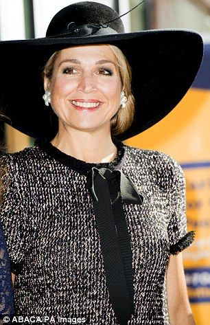 Queen Maxima wears a ruffled wool dress and wide-brimmed black hat in Rotterdam | Daily Mail Online