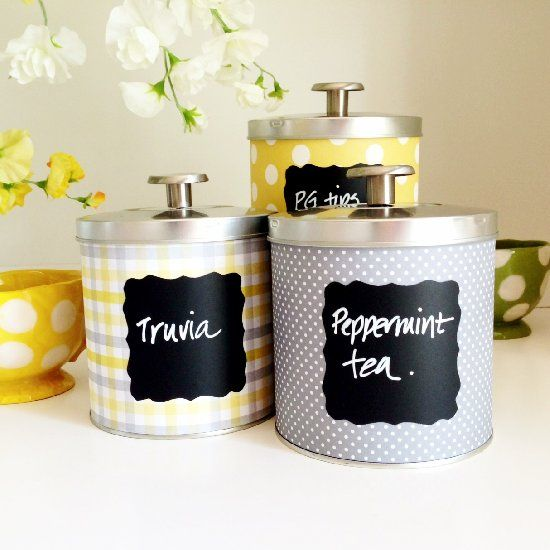 Decorate tin cans with scrapbooking paper to create cute containers for the kitchen or office. Spray with varnish to make them waterproof.
