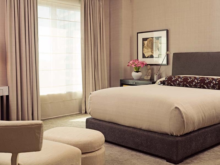Silk walls and a custom linen carpet in the master bedroom muffle the city outside. The designer fashioned the bolster from a little-worn scarf the homeowner had.