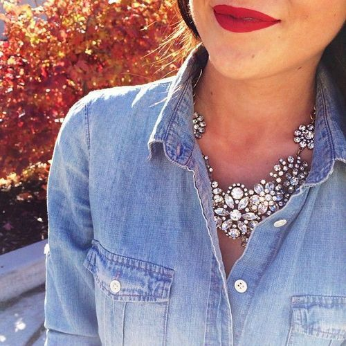 Dress up a chambray shirt by pairing with a sparkly necklace (and red lipstick).