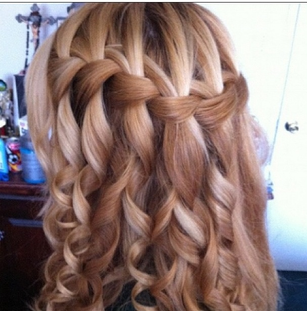 Beautiful waterfall braid curled at the end. Love this!