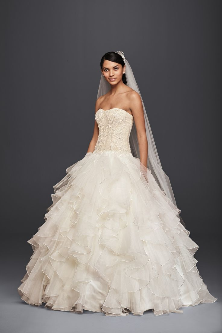 for the traditional bride strapless ruffled skirt ball gown wedding dress by oleg cassini available