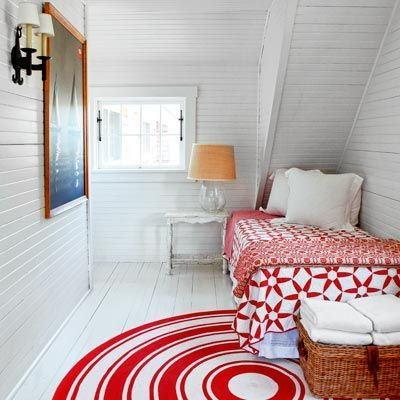 Charming cottage style bedroom decor with red and white. Beadboard walls painted white add to the coastal charm. #bedroomdecor #coastal #cottagestyle #vintagestyle