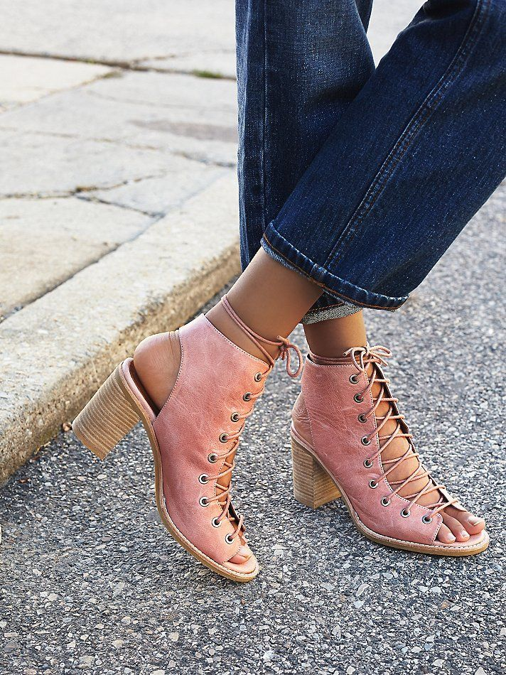 Minimal Lace Up Heel | Distressed leather open-toe lace-up heel. Open at back of heel, too. Stacked heel. Rubber sole.     *By Jeffrey Campbell + Free People    **For optimal comfort, it is best to lace the shoe, beginning with the laces inside the shoe and threading them out through the first grommet.