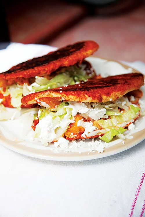 Pambazos: These salsa-dunked and griddled sandwiches, an iconic Mexico City street food, are named for the pambazos—soft, oval rolls—they're typically made with.
