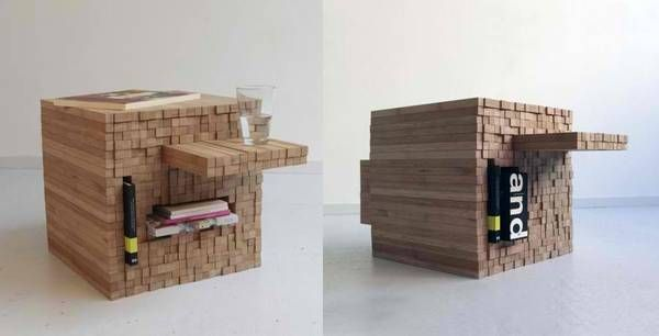 "pixel table. ""When you insert an object into one side, it pushes out the wooden pieces on the other side, making little table-like extrusions"""