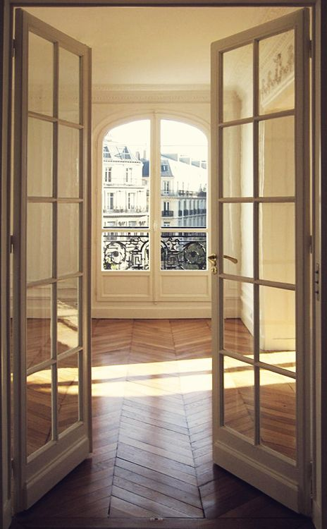 Paris Apartment, their use of Beautiful doors and windows are what makes their homes so charming and full of light