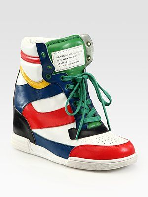 "Marc by Marc Jacobs  Multicolored Leather Wedge Sneakers  Be The First to Write a Review  Supple leather in a sporty, multicolored design with a lace-up front, hidden wedge and oversized tongue.        Rubber wedge, 4"" (100mm)      Rubber platform, 1"" (25mm)      Compares to a 3"" heel (75mm)      Leather upper      Leather lining      Rubber sole      Padded insole"