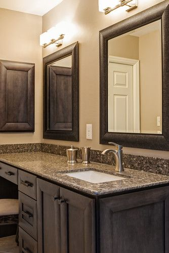 Grey stained vanity, single handle faucet, Silestone counter, double framed mirrors, recessed medicine cabinet. Case Remodeling of Charlotte, NC | Project Designer: Chelsea L. Allard | Deborah Scannell Photography