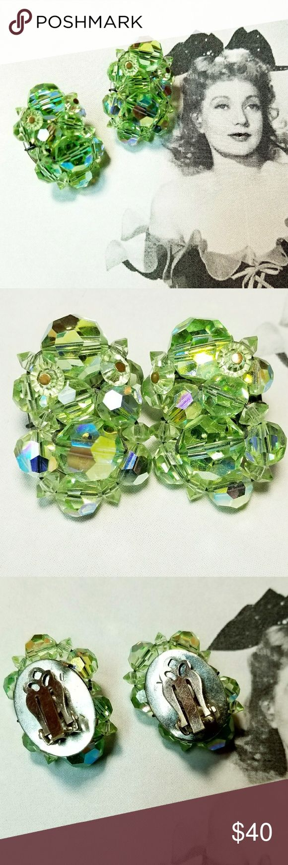 """Vintage Peridot Aurora Borealis crystal earrings Vintage Peridot green Aurora Borealis crystal clip earrings. Measures just over 1"""" tall and just over .5"""" wide. Clips are silver tone and sturdy and in good working order. Excellent vintage condition reasonable offers welcome and accepted. Looks fab with the other peridot AB jewelry listed. Add to a bundle and I'll offer you a great deal ❤ Vintage Jewelry Earrings"""