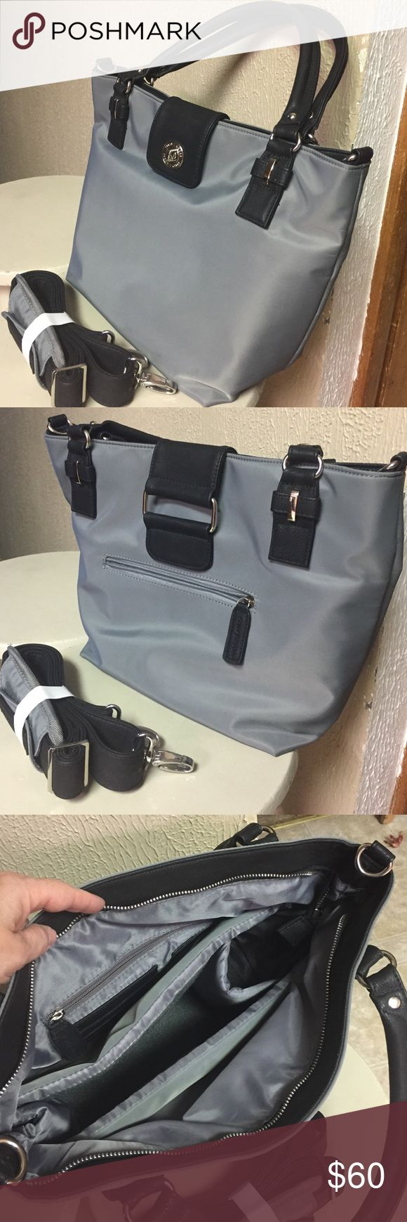 Kelly Moore Handbag/Camera bag Kelly Moore handbag/camera bag. Zip pocket on back. Zip pocket 4 card slots inside. Also comes with removable padded basket to protect camera gear. Can be removed to use as a Handbag. Comes with dust bag & padded shoulder strap. 12(w) 7(d) 11((h) Kelly Moore Bags Shoulder Bags