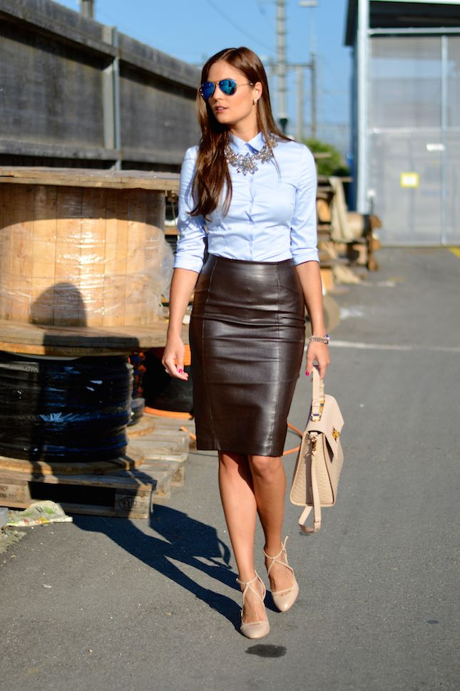 Lara Caspari: Stylish Ways to Wear Leather Ensembles at Work black leather pencil skirt, blue button down, statement necklace + nude heel