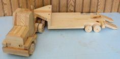 Hey, I found this really awesome Etsy listing at https://www.etsy.com/listing/215775983/pine-wooden-semi-truck-with-lowboy