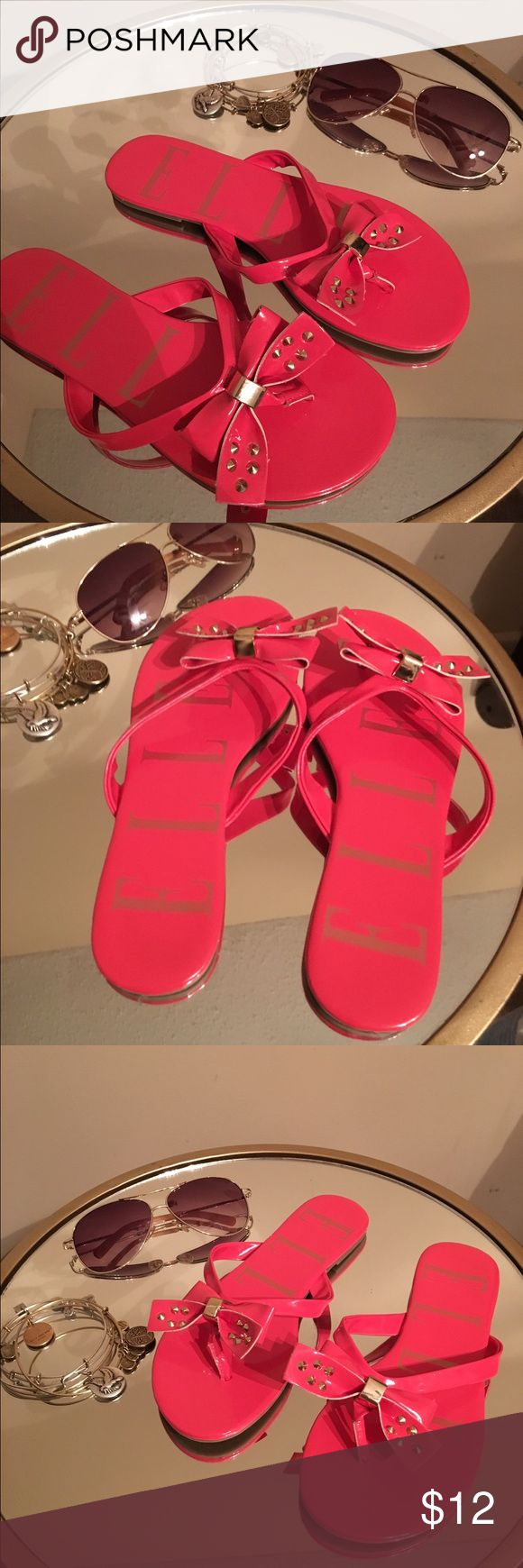 """Elle NWOT Bow Flip Flops Sz 5 So cute for the summer!  Here are a pair of Elle flip flops, new WITHOUT the tag!  Perfect for just about anything!  The bow as a little glam due to the gold studs!  """"Revive"""" this item with your fashion flare! Elle Shoes Sandals"""