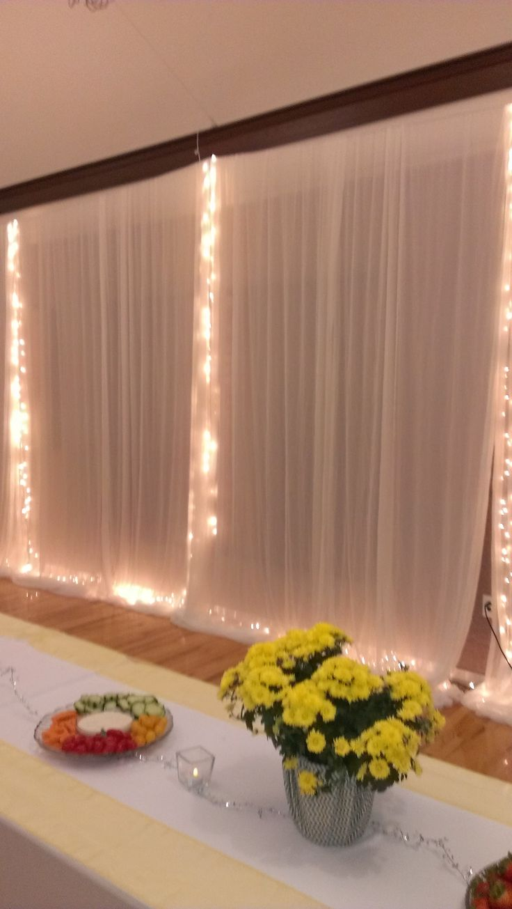 A wedding reception at a LDS Cultural hall - curtains and lights