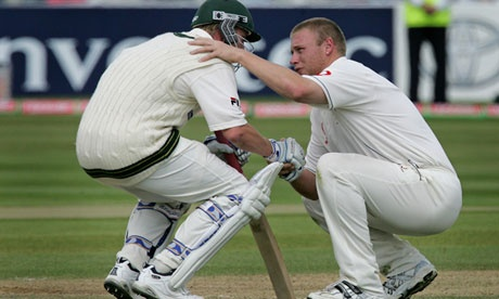 Flintoff consoles Australia's Brett Lee after England narrowly win the Ashes in 2005.