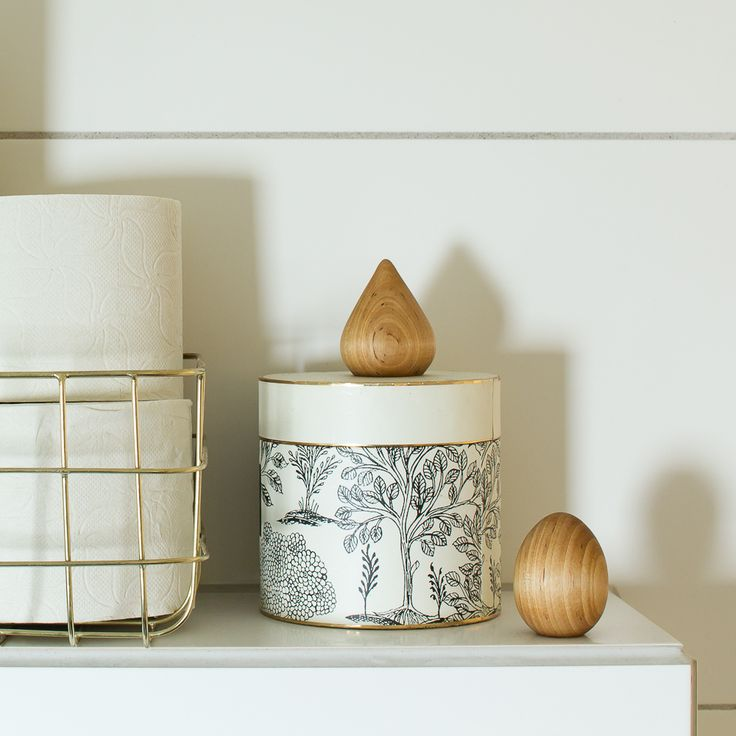 W O O D - The small wooden sculptures is a warm and welcoming touch in an all white bathroom.