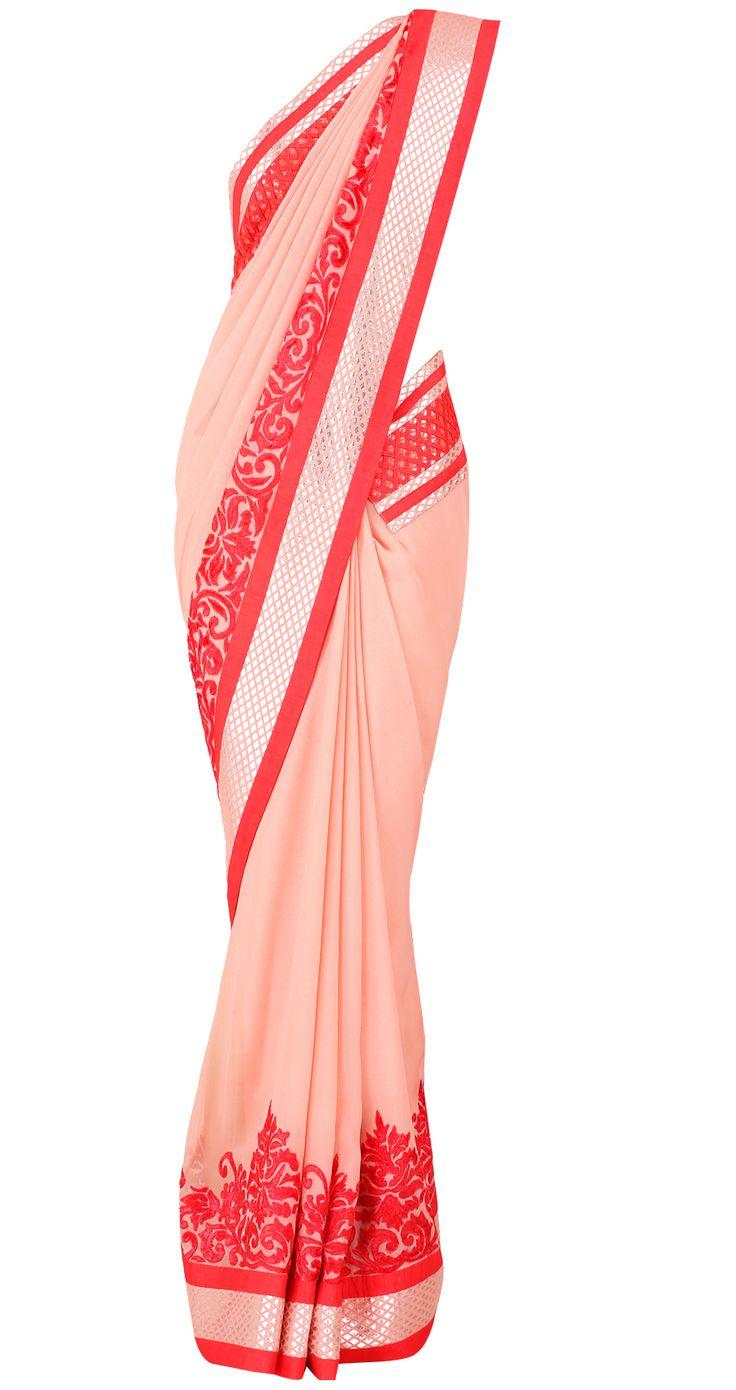 Peach and coral sari with silver cut diamond pattern and velvet cutout border by VARUN BAHL. Shop at https://www.perniaspopupshop.com/whats-new/varun-bahl-1