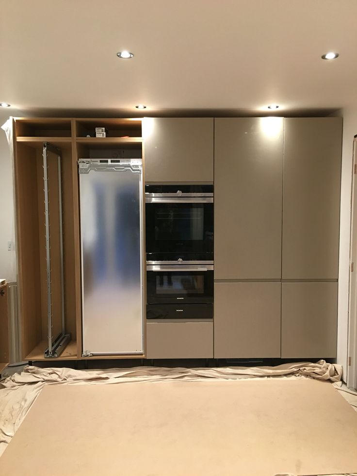 Coming together.... Gloss integrated handle, in stone from Howdens Siemens oven, oven/microwave, warming drawer. Siemens integrated full height fridge.