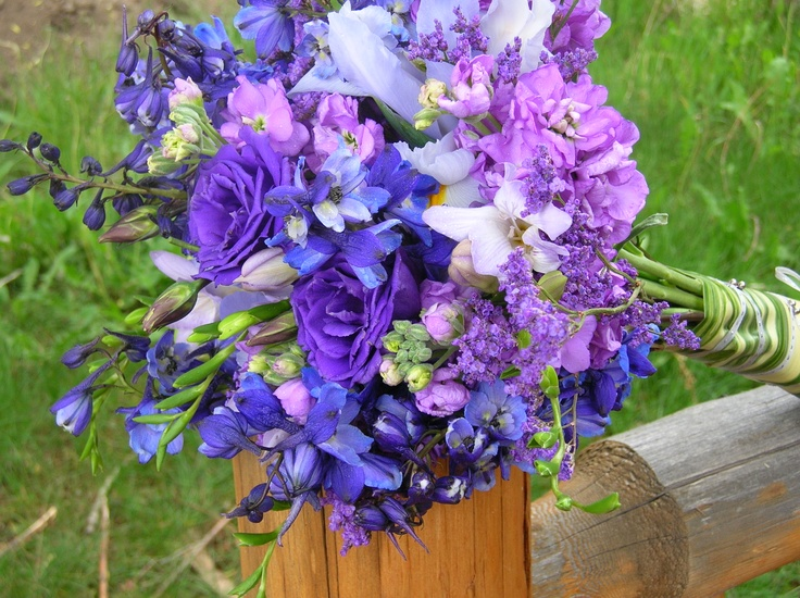 Shades of purples and blues bride's wild flower bouquet.