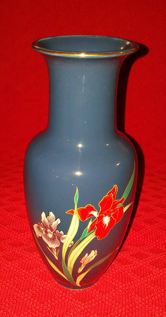 Stunning tall light blue Asian vase by Fine China Japan, decorated with an iris floral motif and gold trim. This 1960s/70s mid century piece looks to be in excellent condition with only a minute chip on the bottom rim, not seen unless closely inspected. This is a gorgeous decorative piece which should not be passed up. Please inspect listing photos, (zoom feature) to determine condition. Thank you so much for visiting, and dont forget to revisit soon.... Joao  Dimensions: H 10-1/2 x...