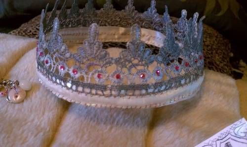 crown made from lace, acrylic silver craft paint, wired cream ribbon with irridescent filament and copper  hand stitching. Also mini pink rhinestones and layered nail enamel for extra shiNy-ness fitting a Queens attire for Renaissance strolling!