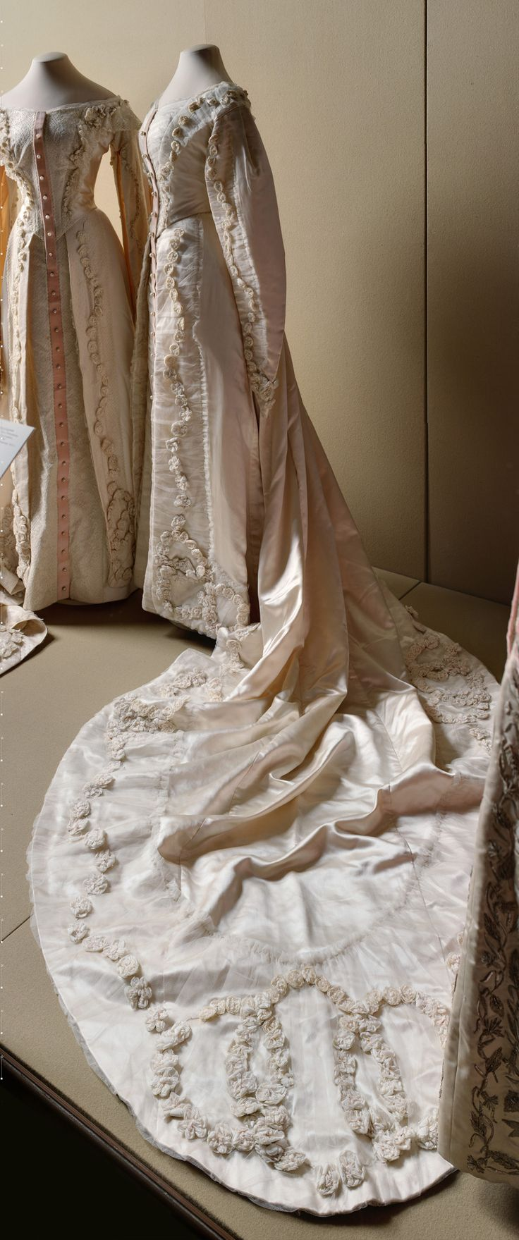 It's rather sad that these dresses stand side by side, like shells of the sisters who once wore them.