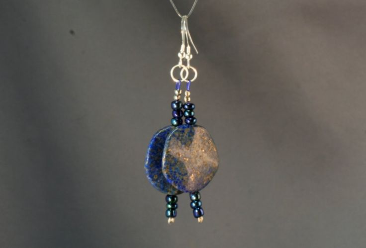 These Lapis Lazuli earrings are 4.5 cm (1.5 inch) long, ear wire not included. The discs are 2.5 cm in diameter.