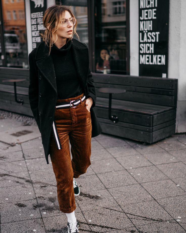 Street Style via Masha Sedgwick |wearing a brown corduroy pants and a sporty, …