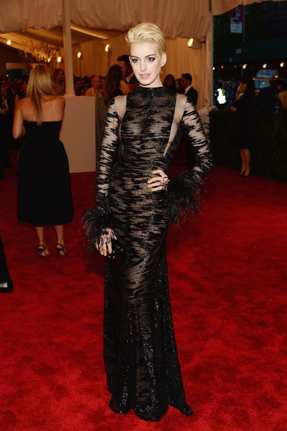 Anne Hathaway debuted a bleach blonde pixie cut at the Met Gala 2013.