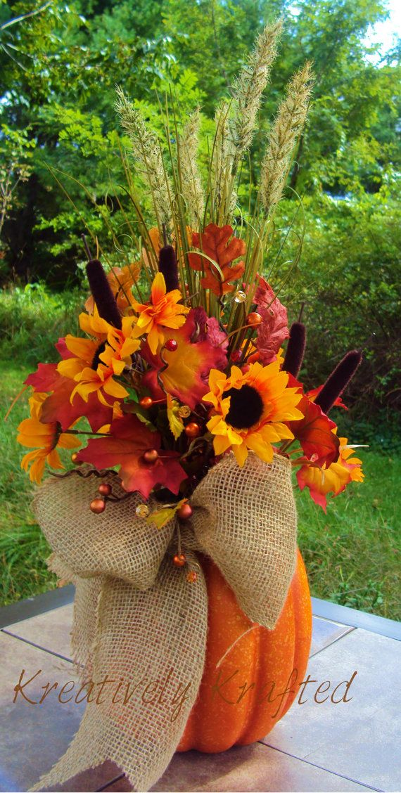 I dont like the flowers in it. But its a pretty idea. all Pumpkin Arrangement Table Centerpiece Thanksgiving, KreativelyKrafted