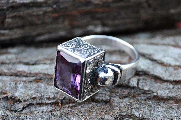 Beautiful bohemian style ring with peacock purple stone