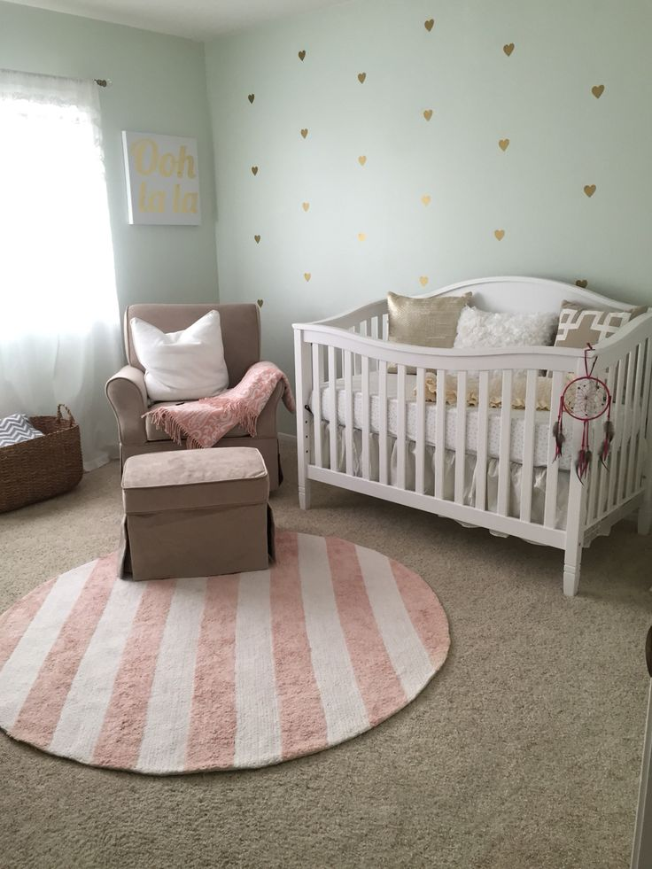 My baby girl's mint green, pink, and gold nursery