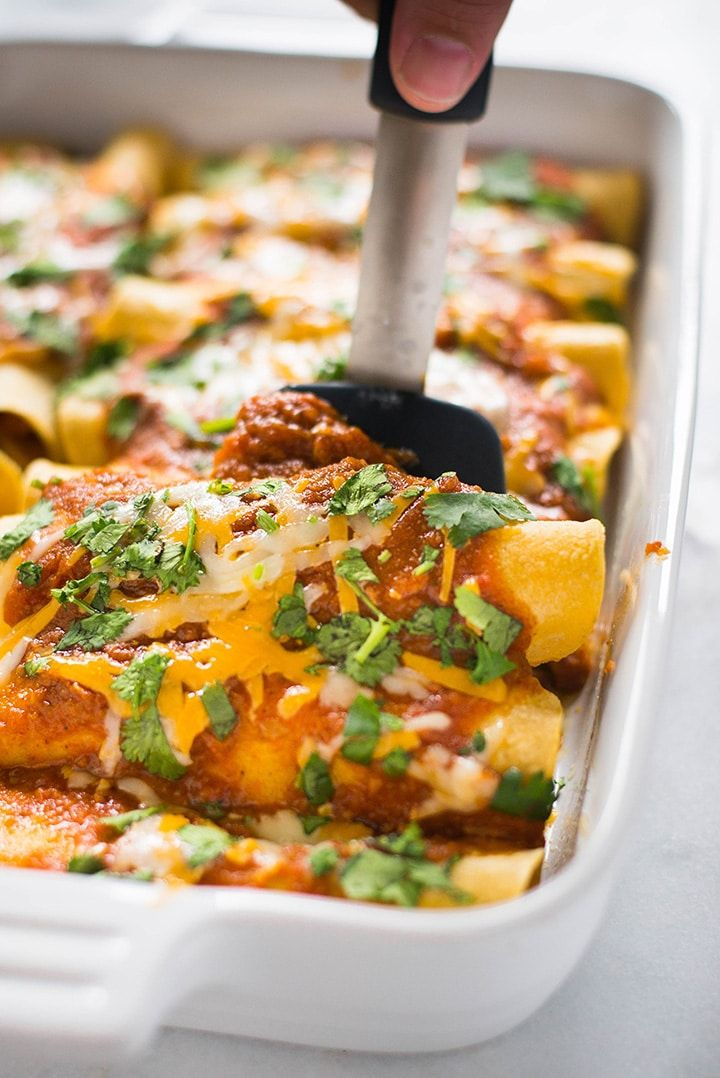 Shredded Chicken Enchiladas | These shredded chicken enchiladas are my absolute favorite enchilada recipe.  Tips for how to make the best chicken enchiladas ever, how to shred chicken, and a handy 10 minute enchilada sauce are all included! | A Sweet Pea Chef via @laceybaier