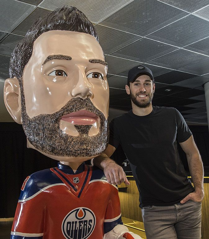 Edmonton Oiler goalie Cam Talbot with his bigger than life bobble head on the concourse of Rogers Place on March 3, 2107. Photo by Shaughn Butts / Postmedia