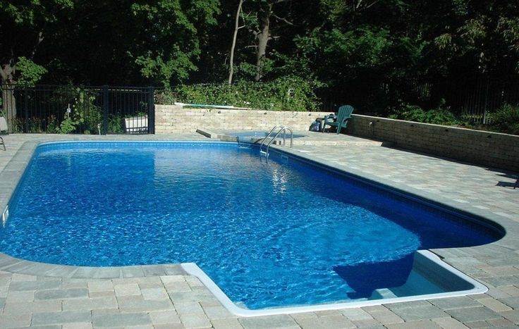 Inground Pool Kits as Fresh Space: Wondeful Moden Style Concrete  With Green View Fence Inground Pool Kits Design Finished With Payer Deck M...