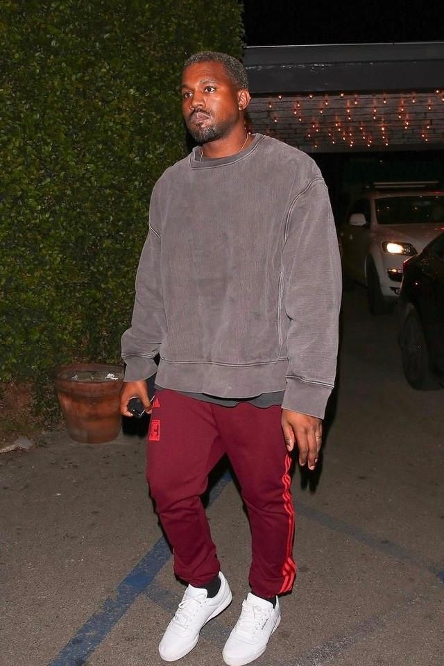 bde54099 Kanye West in LA wearing Yeezy Adidas season Calabasas sweatpants ...