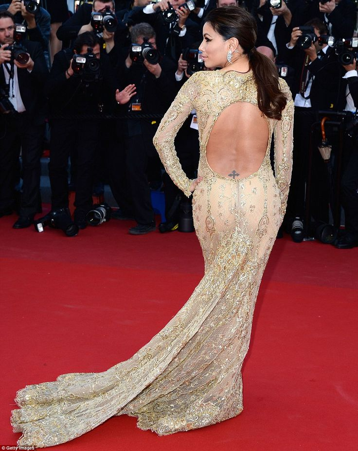 Eva Longoria strikes a pose in a gold gown at the Cannes Film Festival (2013)