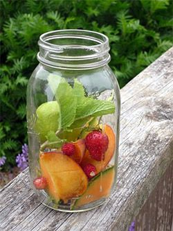 Take a mason jar of fruit and homemade cocktails to your next summer party.