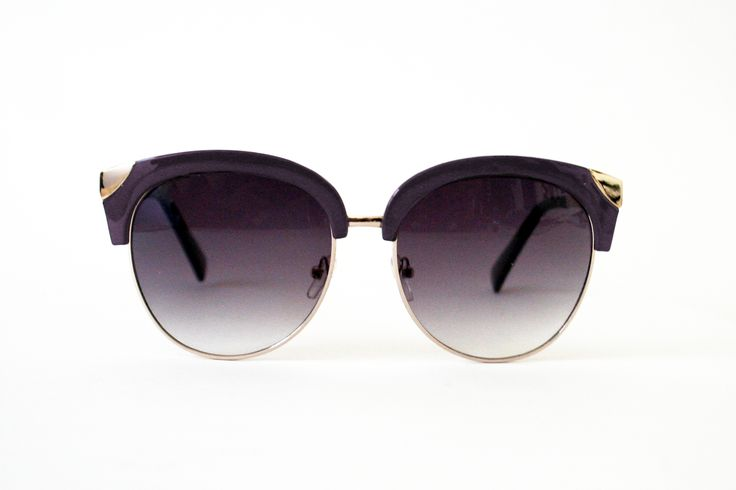 Midcentury Modern Sunglasses: Smoky Lilac/Gold - Classically attractive browline styling mixes with a subdued modern palette to upgrade these sunnies to something special! Wayfarer-inspired shape trimmed with chic wine framing, gradient lenses, adjustable nosepads, and gold hardware gives even more style. Lenses provide UV 400 protection, which blocks all UVA and UVB light rays.